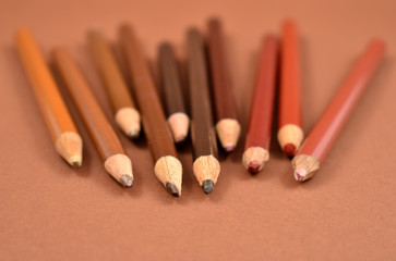 Brown crayons stock images. Set of brown crayons on a brown background. Art supplies images
