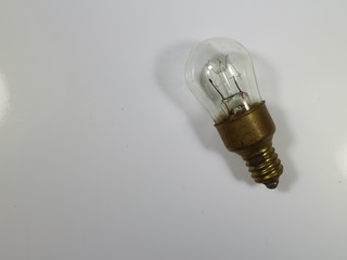 electric incandescent light on white table