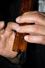 Wooden flute in the man's hands