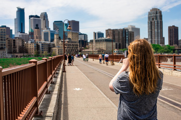 Woman taking picture of city skyline