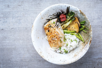 In de dag Vis Modern Japanese fried cod fish filet with green asparagus and rice as top view in a bowl with copy space left