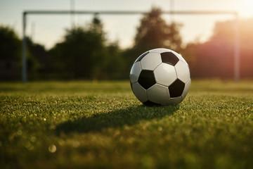 Soccer ball in the sunset