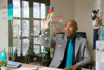 Handsome Business Man Using Futuristic Financial Graph