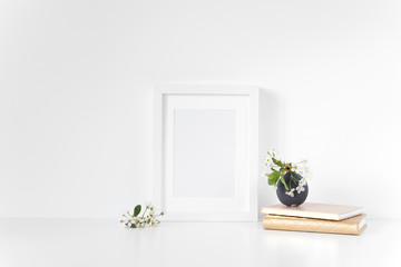 White frame A5 mockup with spring cherry bouquet. Mock up for your photo, design or text.