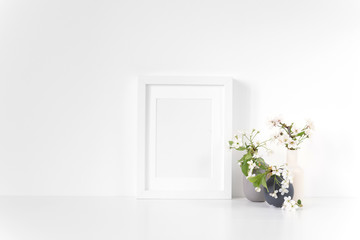 MinimalWhite frame mockup with spring cherry bouquet. Mock up for your photo, design or text.