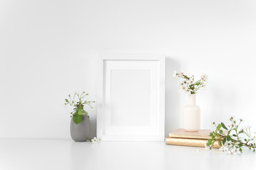 White frame mockup with spring cherry bouquet. Mock up for your photo, design or text. Background