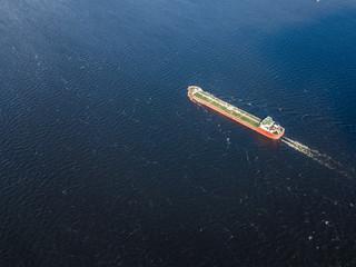 single alone cargo barge in the sea