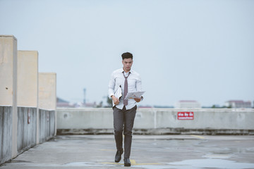 Unemployed businessman stress sitting on stair,