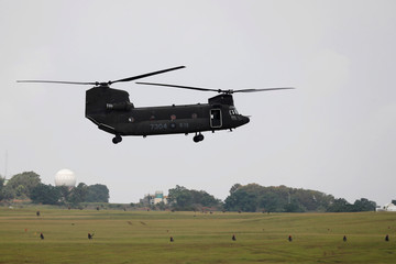 A CH-47 Chinook helicopter takes part in Han Kuang military drill simulating the China's People's Liberation Army (PLA) invading the island, at Ching Chuan Kang Air Base, in Taichung