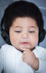 Cool baby listening to music