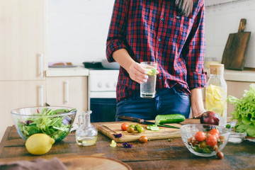 Young woman cooking healthy simple food home kitchen sunny evening Healthy food concept