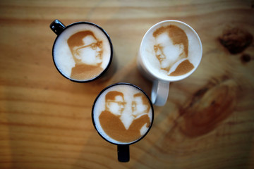 Pictures of North Korean leader Kim Jong Un and South Korean President Moon Jae-in are printed on top of milk foam of lattes at a coffee shop in Jeonju