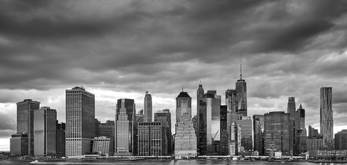 Black and white Manhattan panoramic picture with stormy sky, New York City, USA.