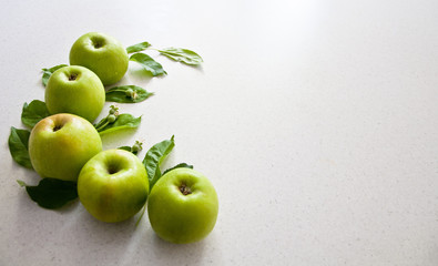 green apples on the white table