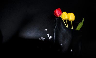 beautiful tulips and black bag, interesting