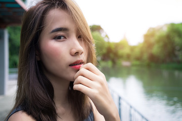 Portrait Happy woman. beauty girl smile face..Close up lady skin confident cute model healthy care..Pretty Teenage female relax expressive..green nature outdoor summer lifestyle.
