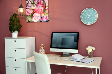 Stylish workplace interior with computer monitor on table