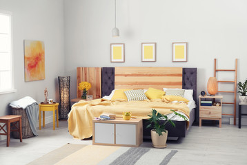 Interior of beautiful room with comfortable double bed