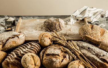 Raw dough - making loaf of bread - small bakery scenery