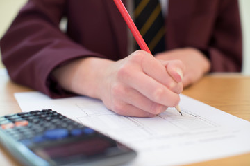 Close Up Of Female Pupil In Uniform Taking Multiple Choice Examination Paper