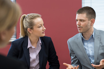 Businessman And Businesswoman In Mediation Meeting