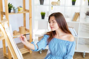 Creative woman working in art studio