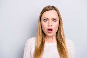 Portrait of shocked frustrated girl with long hair wide open mouth looking at camera isolated on grey background having failure problem
