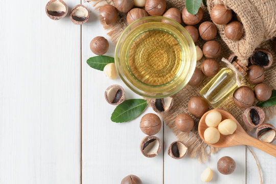 Bowl of macadamia nut oil and macadamia nuts