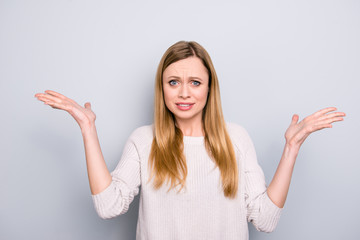 Portrait of frustrated confused girl gesturing with palms isolated on grey background conflict scandal dispute insult offense concept