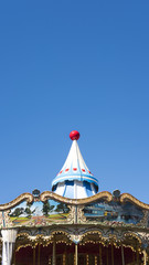 Vertical cropped shot in motion of ornate hand-painted roof of famous vintage carousel on Pier 39, San Francisco, California, USA