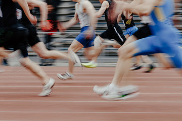 legs men sprinters runners running athletic track