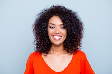 Portrait of cheerful joyful woman in orange outfit with white smile plump lips looking at camera isolated on grey background. Treatment therapy toothache ache problem concept