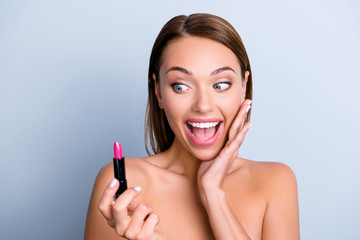 Sale discount lipcare open mouth emotion therapy treatment makeover sensual trend present concept. Close up portrait of astonished excited girl holding lipstick isolated on grey background