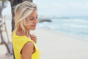 Attractive sensual blond woman at the beach