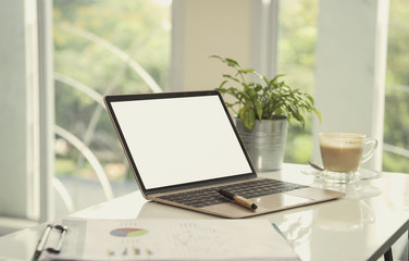 Open laptop and blank screen for mockup template advertising and branding technology background.