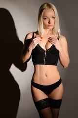 Sensual lady posing in panties stockings and denim bra