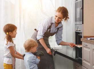 mother with children   baking cookies