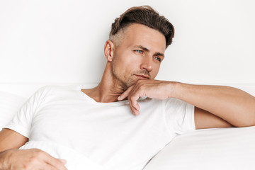 Concentrated man laying in bed