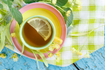 Cup of herbal tea with linden blossoms and lemon
