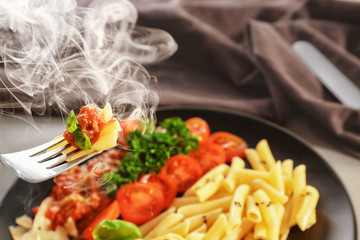 Eating of tasty pasta with bolognese sauce, closeup