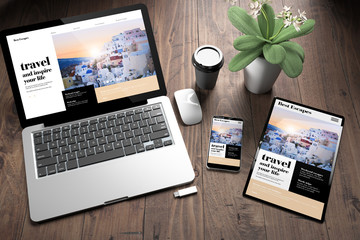 Wall Mural - three devices on wooden desk top view travel online