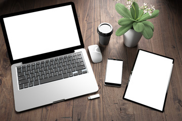Wall Mural - three devices on wooden desk top view