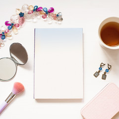 Blank  book isolated on white textured wood background with cute women's accessories. Flat Lay notebook. Top View. Copy space