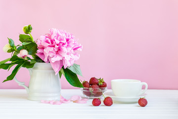 A cup of tea and peonies