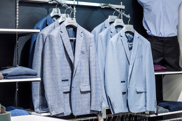 men's suit on shopping retail store. shop and sale concept