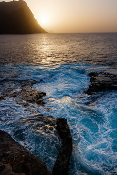 Dusty sunset and turbulent waves at the rocky beach of Santo Antao Island, Cape Verde