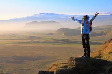 Female tourist enjoying the beauty of Iceland landscape