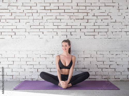 Portrait of smiling woman before exercises  Brunette with