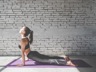Portrait of attractive woman doing exercises. Brunette with fit body on yoga mat. Healthy lifestyle and sports concept. Series of exercise poses.