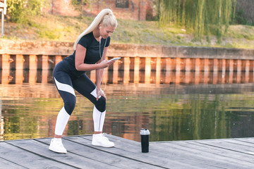 Woman doing stretching by the river